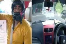 Pengakuan Pengemudi Mobil yang Selalu Pakai Helm, Ternyata - JPNN.com
