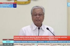 Menuju Fase Endemik, Malaysia Pangkas Ratusan SOP COVID-19 - JPNN.com