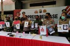 Polres Gresik Tangkap Pelaku Penyebar Hoaks Vaksinasi Tewaskan Kasdim 0817 - JPNN.com Jatim