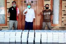 KAHMI Situbondo Bagi-bagi Nasi Kotak ke Warga Terpapar Covid-19 - JPNN.com Jatim